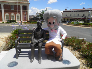 The Professor chats to Henry Lawson, in the main street of Grenfell.