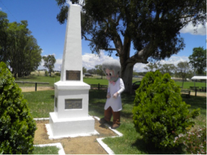 Checking out the plinth marking Henry Lawson birthplace. The sugar gum in the background was planted by Henry's Daughter, Bertha.